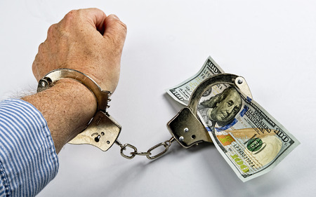 Man made prisoner to cold hard cash. photo