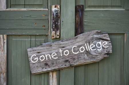 education loan: Old gone to college sign on doorway. Stock Photo