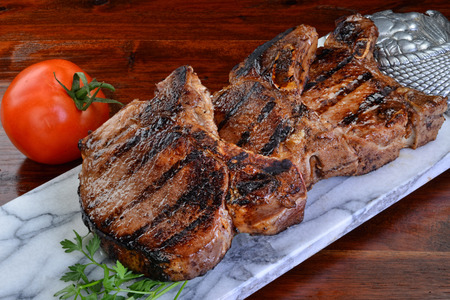 loin: Thick two inch pork chops. Stock Photo