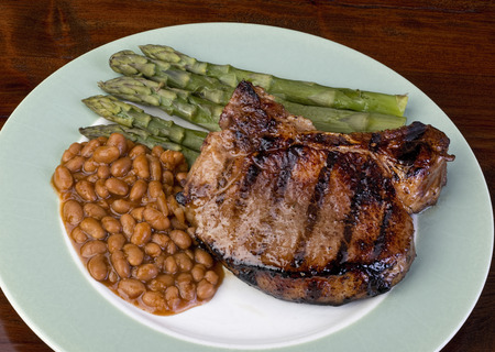 pork chop: Thick pork chops,beans and brussels sprouts.