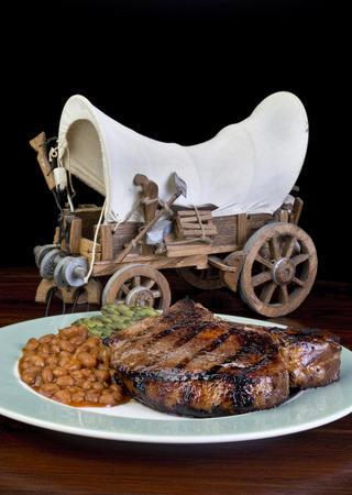 Thick two inch pork chops and cowboy wagon . photo