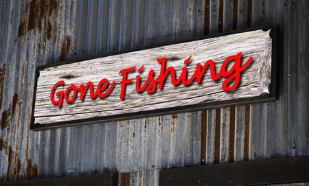 gone: Old gone fishing sign. Stock Photo