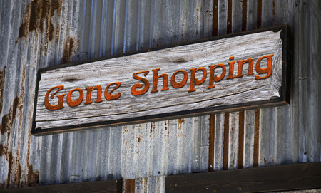 retailer: Old gone shopping sign.