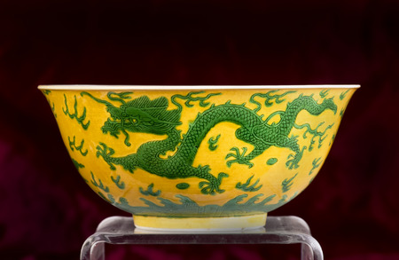dynasty:  Chinese 19th century green and yellow dragon bowl , Qing dynasty.