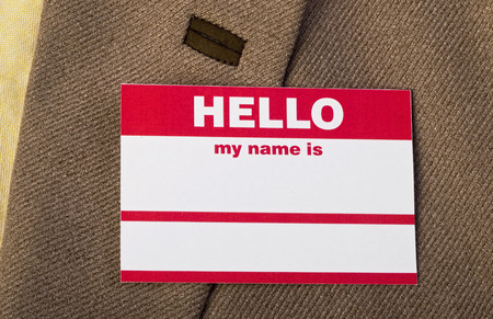 Name tag on jacket for you to fill out. Stock Photo