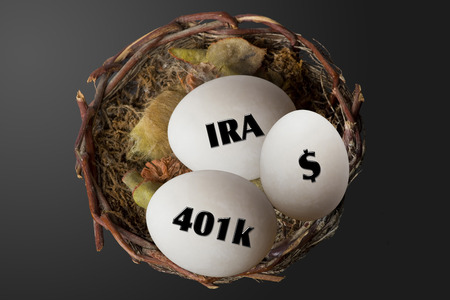 Nest eggs of 401K,IRA and dollars. Stock Photo