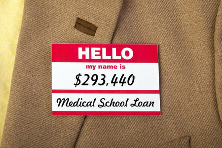 medical school:  Medical School student loan name badge on jacket. Stock Photo