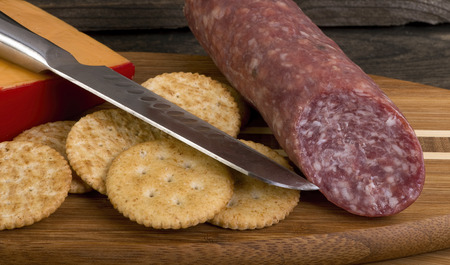 Smoked salami,cheddar cheese and crackers.