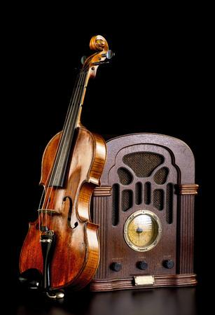 Old antique radio and maple violin. Stock Photo