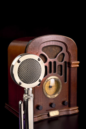 Old antique radio and chrome microphone. photo