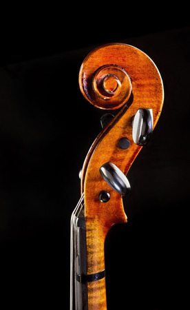Antique maple violin neck and scroll.