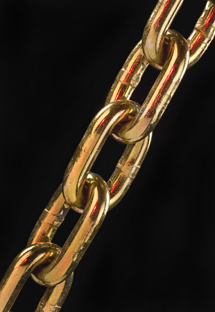 Closeup of golden chain with room for your type. Stock Photo