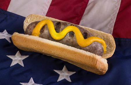 Grilled bratwurst on American flag. Stock Photo
