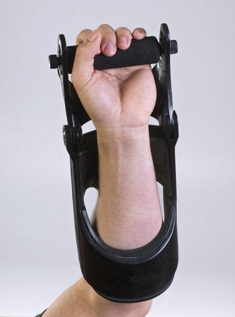 Strength training with wrist exerciser. Stock Photo