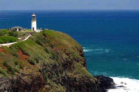 Kauai, Hawaii lighthouse on top of tall cliff.