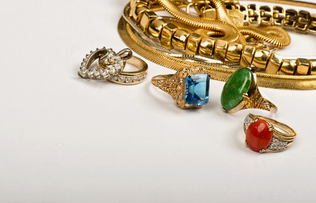 scrap gold: Scrap gold jewelry with room for your store advertisement. Stock Photo