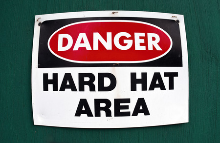 workplace safety: Danger hard hat area sign.