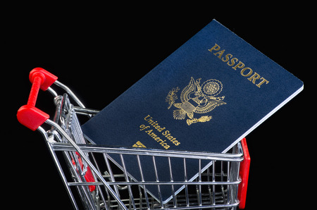 pp: American passport in shopping cart.