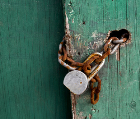 pad lock: Rusty chain and pad lock with room for your type. Stock Photo