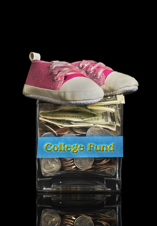 college fund savings: College fund jar for your little child. Stock Photo