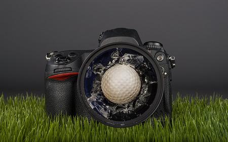 Golf ball hits the camera lens. Stock Photo