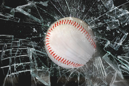 Fast baseball through glass window. Stock Photo