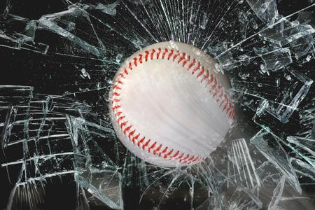 window: Fast baseball through glass window. Stock Photo