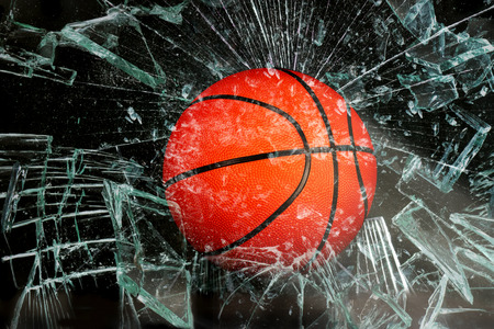 leather ball: Basketball breaking glass.