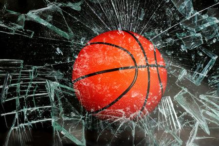 break fast: Basketball breaking glass.