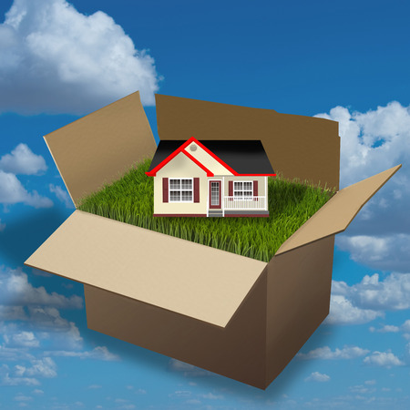 moving box: Home moving in a cardboard box. Stock Photo