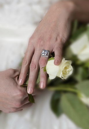 wedding band: Bride showing off  large wedding ring.