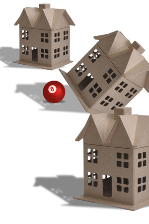 eight ball: Home tilted by eight ball. Stock Photo
