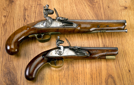 muzzleloader: English 18th century flintlock pistols.