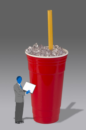 Drinking the healthy drink out of a red cup. Stock Photo