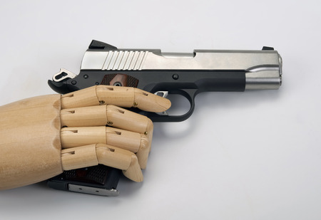 45 Caliber handgun with wooden arm. photo