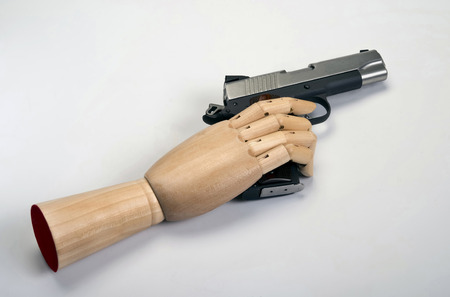 45 caliber: 45 Caliber handgun with wooden arm.