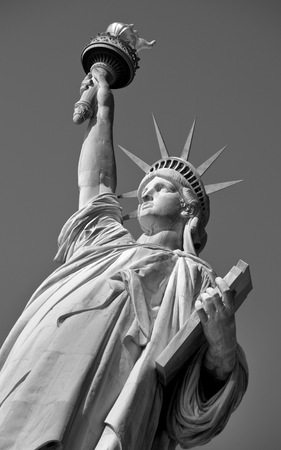 statue: Statue of Liberty on Hudson River in NYC in black and white.