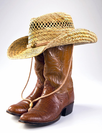 Cowboy lizard skin boots and straw hat.
