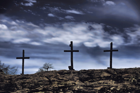 bible and cross: The old rugged wooden cross of the christian church. Stock Photo