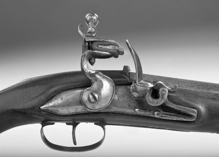 muzzleloader: French 18th century flintlock pistol in black and white.