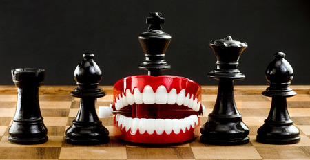 chomp: Chess players a game of war chomping your way ahead. Stock Photo