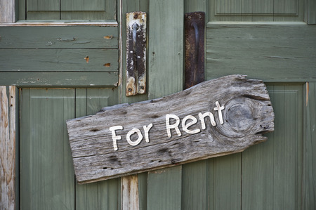 renter: For rent sign on old green doors.