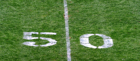 Football fifty yard line makes for a great background. Stock Photo