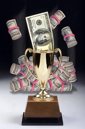 rubberband: American money winner in a gold trophy.
