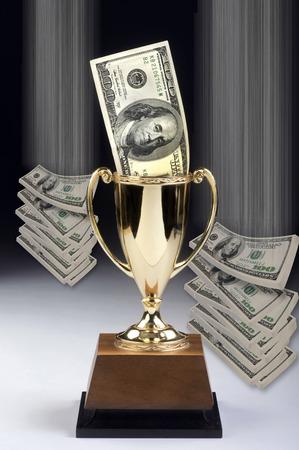 ben franklin money: American money winner in a gold trophy.