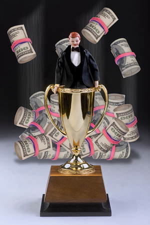 Man of the year in tuxedo with cash falling from the sky.