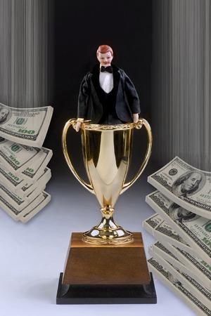 ben franklin money: Man of the year in tuxedo inside a winning trophy. Stock Photo