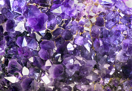 semiprecious: Closeup of amethyst crystals makes for cool background.