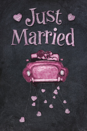 Just married on blackboard in chalk.