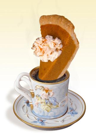 pumpkin pie: Fresh coffee and golden brown pumpkin pie.